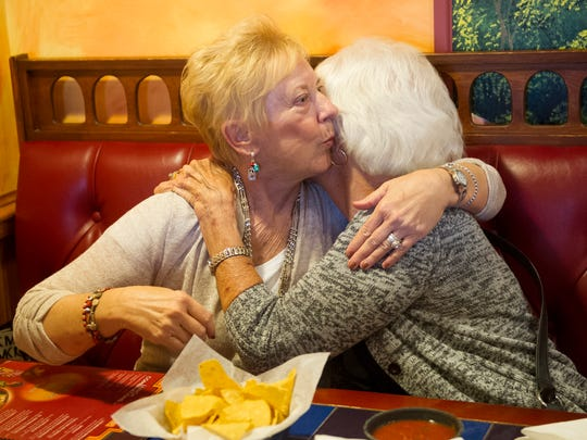 Brenda Willner and Mary Simon, greet each other before dinner at Los Bravos in Evansville Monday. Willner, Simon and Carol Hunter shared a room in the hospital and became friends after their children were born 50 years ago.