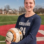 Erin Herbert, 17, a junior at Sacred Heart Academy, plays center midfield for the school's  soccer team. Jan. 28, 2016