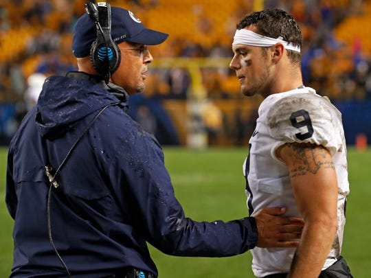 Penn State coach James Franklin, left, talks with quarterback Trace McSorley during the second half of an NCAA college football game against Pittsburgh in Pittsburgh, Saturday, Sept. 8, 2018. Penn State won 51-6. (AP Photo/Gene J. Puskar)