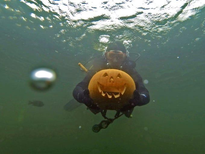 Sport Diver Eli Ruediger, shows off his carved pumpkin