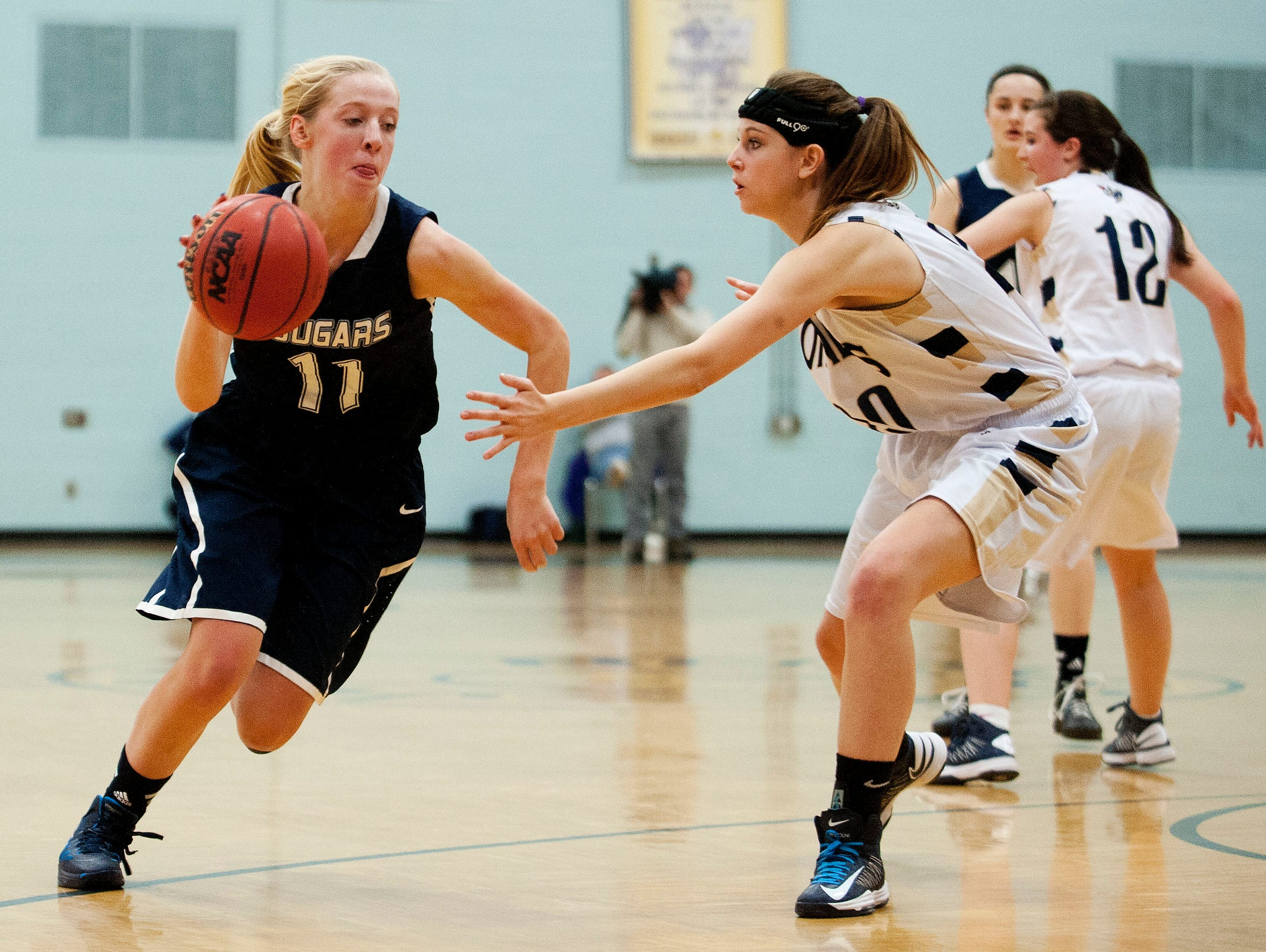 Mount Mansfield's Colby Knight (11) drives to the hoop