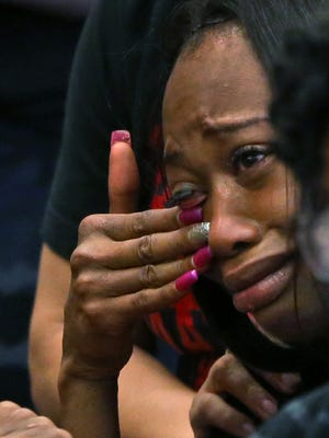 Erica Bailey, daughter of Aaron Bailey, tears up as she hears IMPD officer Michal Dinnsen shout a command as he did on the night of the police action shooting, during the Civilian Police Merit Board hearing, Thursday, May 10, 2018.  IMPD officers Carlton Howard and Michal Dinnsen fatally shot unarmed black motorist Aaron Bailey last summer.