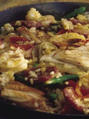 "Find an ""Easy Paella"" recipe in Back to Basics that"