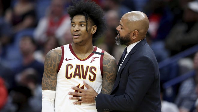 Cleveland Cavaliers head coach J.B. Bickerstaff talks to guard Kevin Porter Jr. (4) during a time out in the second half of an NBA basketball game in New Orleans, Friday, Feb. 28, 2020.