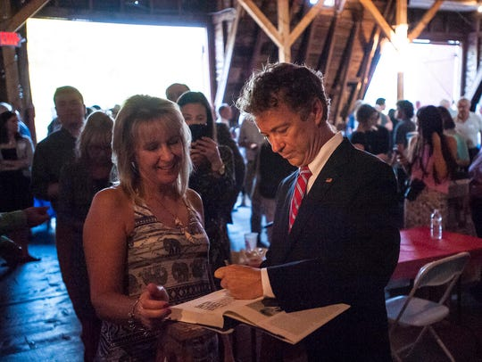 Republican candidate for president Sen. Rand Paul signs