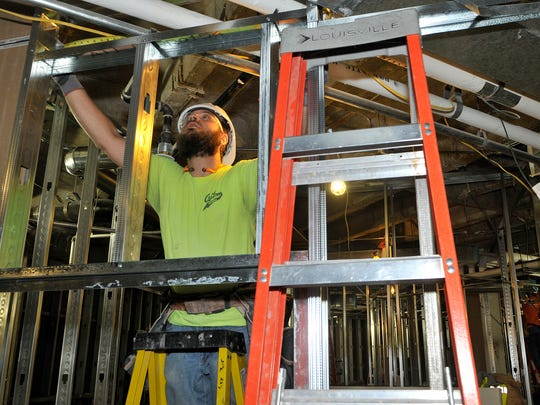 Andrew Laudenbach of Custom Drywall in St. Paul works Monday, Nov. 30 in an area that will become six behavioral health patient rooms within the emergency department. St. Cloud Hospital is revamping its emergency department.
