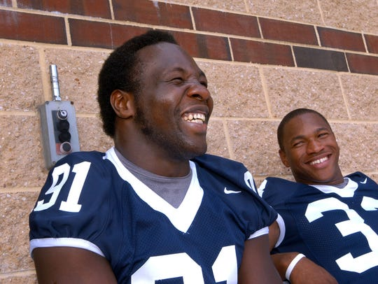 Penn State defensive end Tamba Hali (91) and tailback