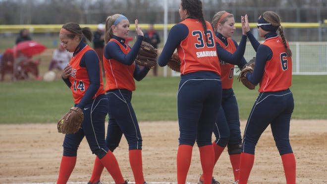 Millville players regroup in the second inning against Vineland on Friday at home.