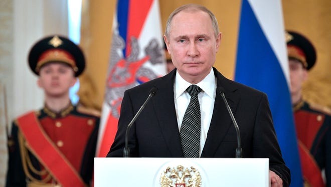 Russian President Vladimir Putin speaks during a ceremony of presenting national awards marking the Defender of the Fatherland Day in the Kremlin in Moscow, Russia, on Feb. 23, 2018.