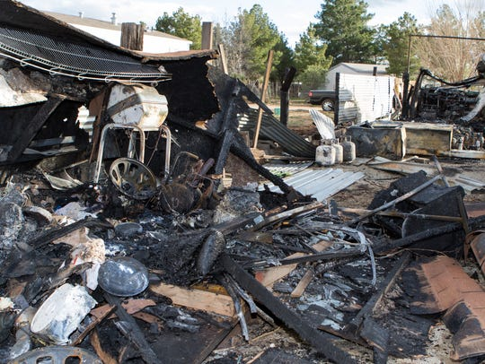 A storage shed and a parked RV also caught fire.