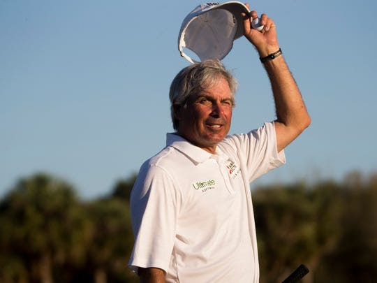 PGA Tour Pro Fred Couples tips his hat to the crowd
