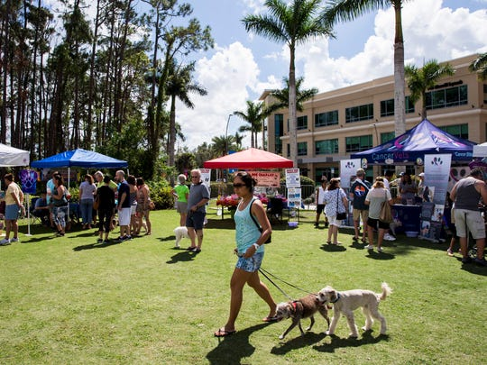 Pet-related vendors set up booths on the lawn at Mercato in North Naples for the 6th Annual Woofstock on Sunday, Feb. 25, 2018.