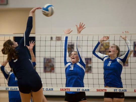 Brooke Mahn (blue, right) in action for St. Clair.