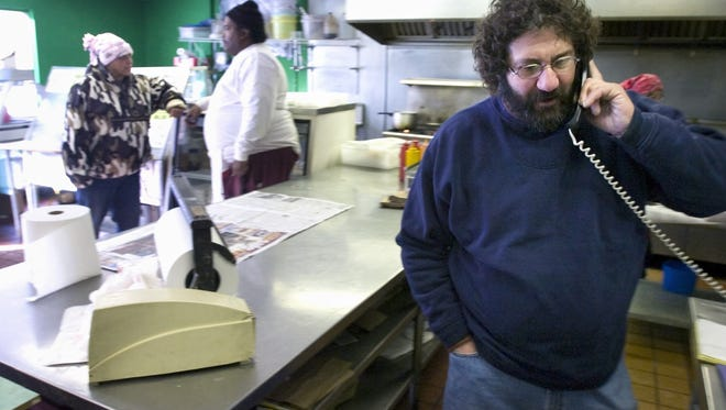 Irving Feldman takes a call asking about his dad, Jack, after the elder Feldman was shot during a robbery of their Joseph Avenue fish market in 2007.