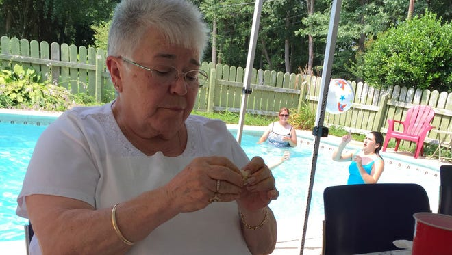 Mama picks apart a crab to get at the meat during a recent family gathering.