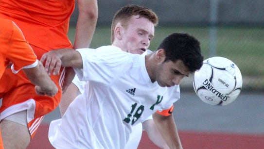 Yorktown's Enzo Sangiacomo heads the ball during a