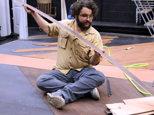 """Florida SouthWestern State College student Ryan Skrzypek, 19, helps with the set for """"Paragon Springs"""" FSW students plan to perform the play next month."""