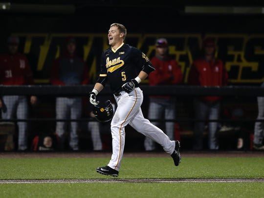Tyler Cropley jogs home after his walk-off grand slam