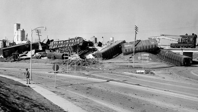 The scene of a massive train derailment just south what used to be the traffic circle on Treadaway Boulevard on Jan. 10, 1958. The wreck had occurred the night before and while one man had briefly been trapped beneath a pile of Sheetrock, no one was reported injured.