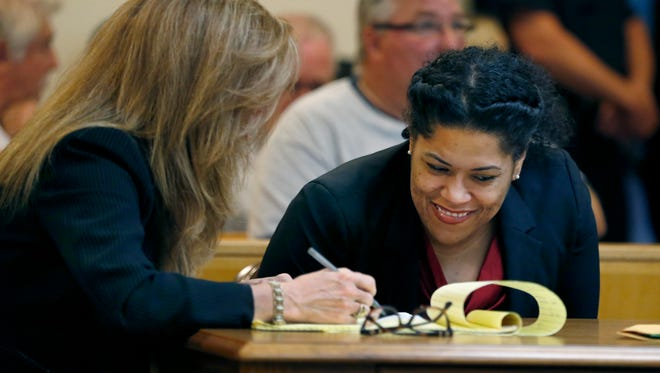 Judge Leticia Astacio makes her court appearance with attorneys Bridget Field and Mark Young.