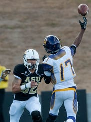 Alabama State's Kourtney Berry (32) pressures Miles