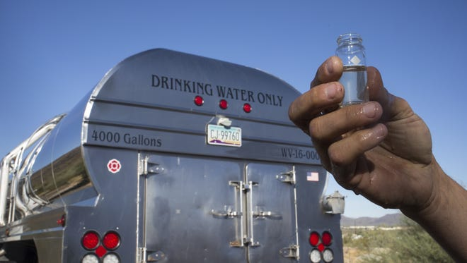 Damon Bruns of Dynamite Water tests water quality on Sept. 25, 2017, before filling his truck from a Phoenix hydrant at Interstate 17 and Pioneer Road.