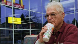 Wayne Turner enjoys a meal at McDonald's n Coudersport, Pa., in a 1997 file photo