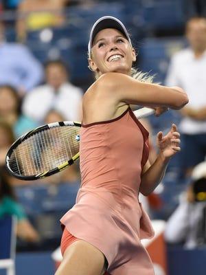 Caroline Wozniacki celebrates beating Sara Errani to advance to the semifinals of the U.S. Open.