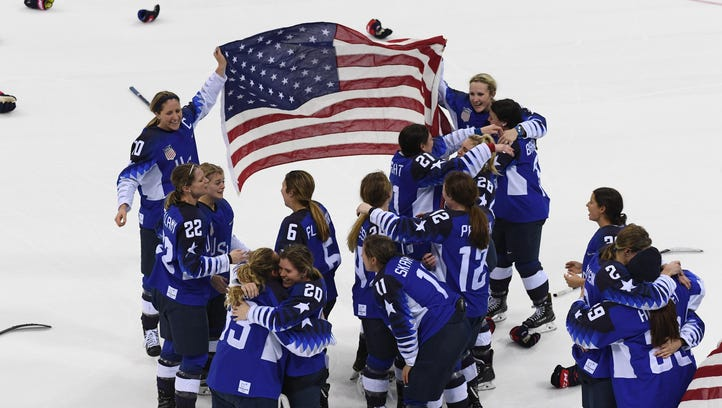 United States players celebrate after defeating Canada