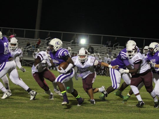 DeSoto Central running back Alan Lamar (2) is chased by Horn Lake defenders on his way to 297 yards and four touchdowns in the Jaguars' 42-28 division victory over the Eagles Oct. 2.