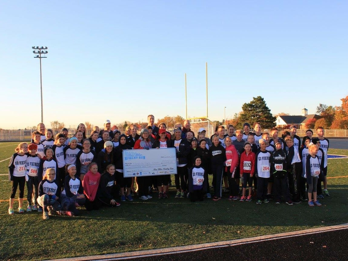 Participants from Marysville pose for a photo after being named as the largest district participant. The winning district was awarded a $2,000 check.