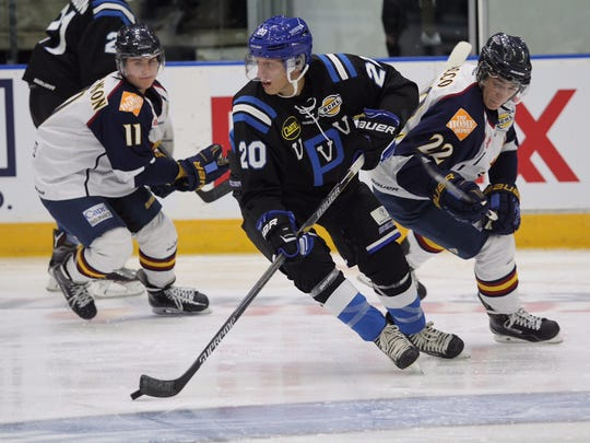 St. Cloud State recruit Easton Brodzinski (20) carries the puck for the Penticton Vees.