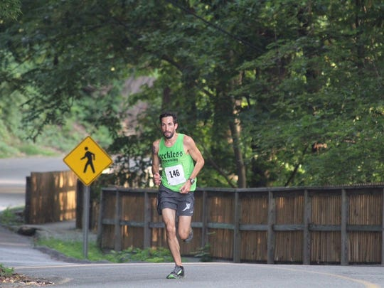 Anthony Famiglietti fo Davidson, wins the Race to the Rock 5K in 2015. The two-time Olympian will compete in the 10K Dam Run Aug. 12 at the Lake Lure Olympiad.