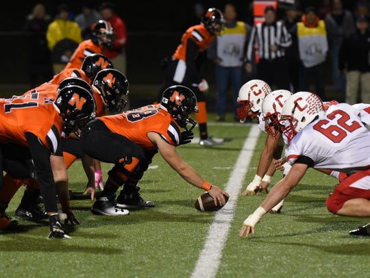Northville and Canton linemen prepare to do battle