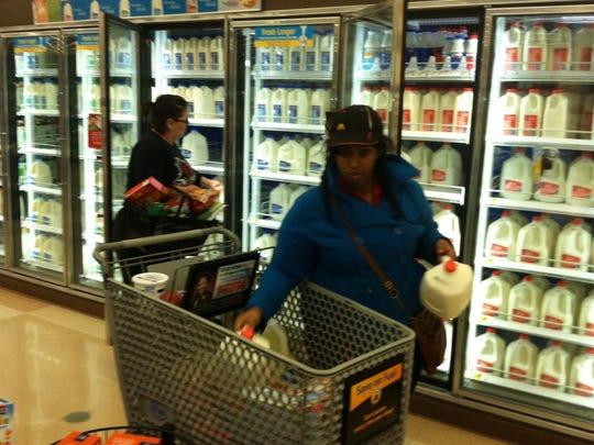 Angelique Woodson stocks up with two gallons of milk