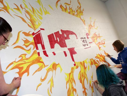 Maine-Endwell Central School District art students paint a mural at the Endwell Fire Station.