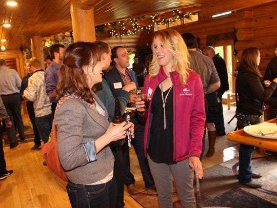 Young professionals socialize at an event through Current-Wisconsin