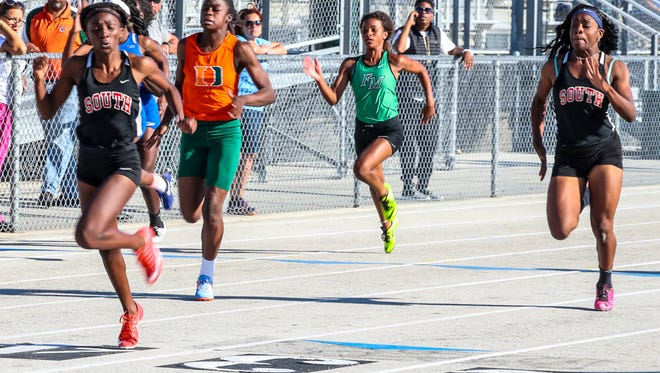 South Fort Myers's Mirlege Castor wins the 100-meter dash at the Lee County Athletic Conference championships Saturday at Island Coast High School.