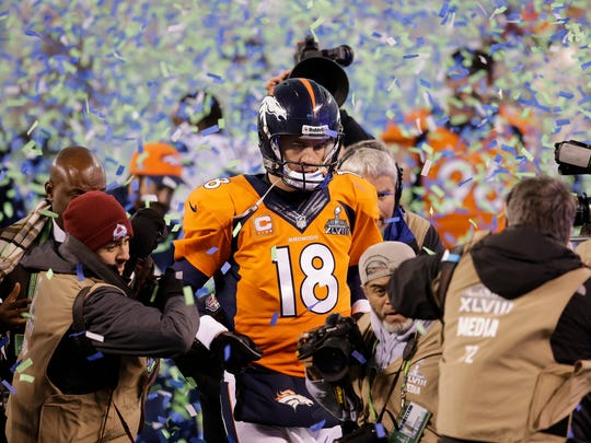 In this Feb. 2, 2014 file photo, Denver Broncos quarterback Peyton Manning walks off the field after the Broncos lost to the Seattle Seahawks in the Super Bowl.