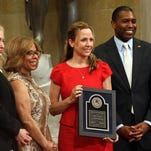 Jamie Balson holds a Justice Department award with, from left, Joye Frost, director of the Office for Victims of Crime, Assistant Attorney General of the Office of Justice Programs Karol Mason and Associate Attorney General Tony West.