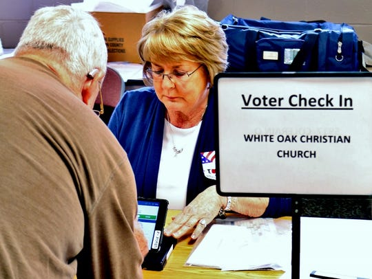A voter checks in at White Oak Christian Church, which
