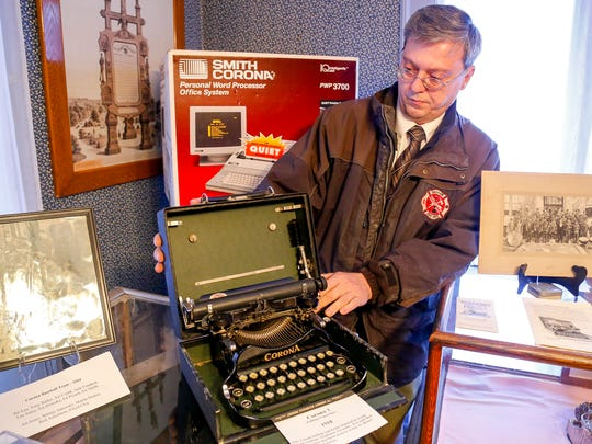 Groton town historian Lee Shurtleff shows a Corona 3 in its original carrying case at the Groton Historical Society. The Corona 3 had a folding typebar, allowing it to fit in the case.