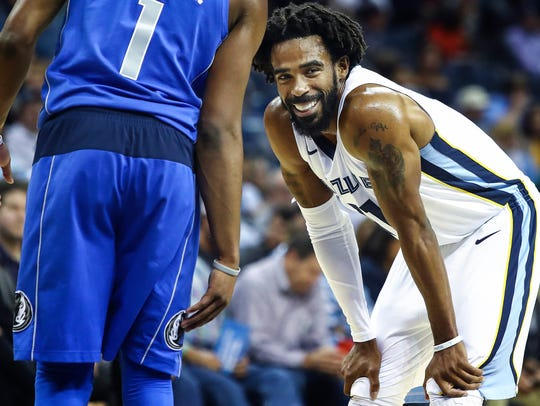 Memphis Grizzlies guard Mike Conley smiles during action