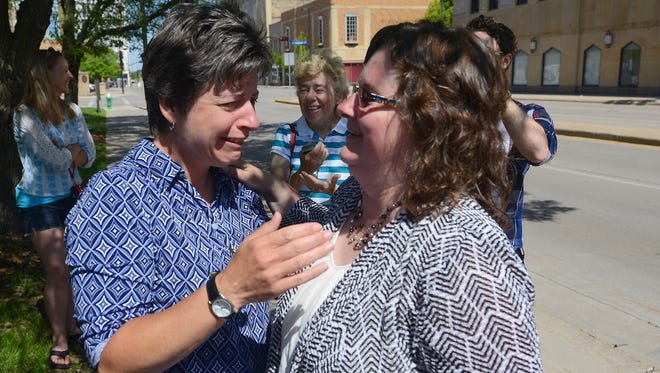 Julie Tetzlaff, left, and Stacie Christian of Green Bay celebrate their wedding on June 9. They  have been together for 21 years and are plaintiffs in a lawsuit filed by the American Civil Liberties Union.