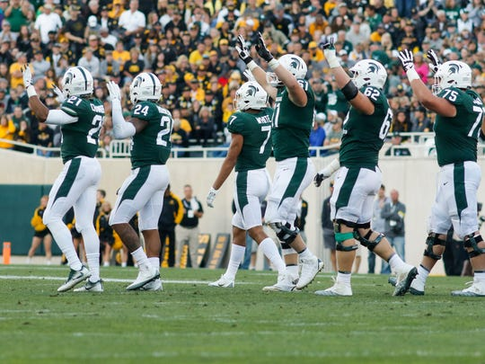MSU gridders celebrate  after stopping Iowa Saturday, Sept. 30, 2017, at Spartan Stadium in East Lansing.