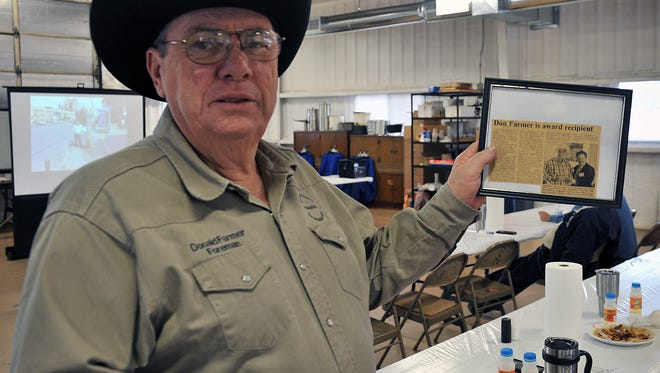 Wichita County Precinct 2 Foreman Don Farmer displays a newspaper clipping from when he won the Making A Difference award from the Texas Association of Counties in 2010. Thursday Farmer received it again for his safety efforts.