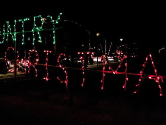 """Vehicles stream into the """"Country Christmas"""" drive-through holiday lights display at the Country Springs Hotel in Pewaukee."""