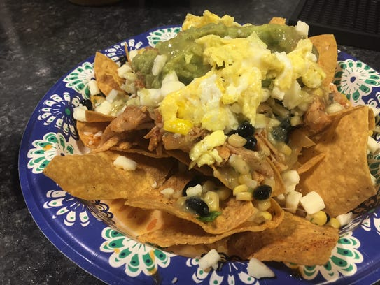 Chilaquiles with chicken, scambled eggs and guacamole