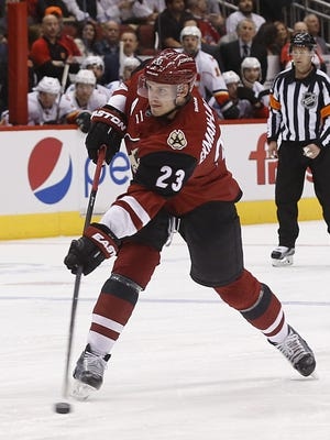 Coyotes' Oliver Ekman-Larsson (23) scores a goal against the Flames during the second period at Gila River Arena in Glendale, Ariz., on Friday, February 12, 2016.
