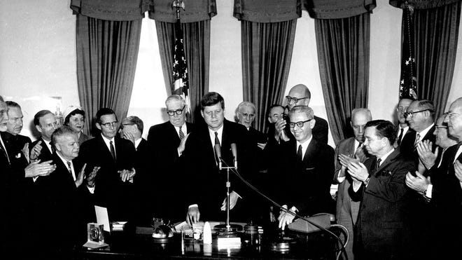 President John F. Kennedy Signs HR 3935 Public Law 87-30 Minimum Wage Act, May 5, 1961.